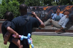 Attendees take in an art installation on Greenwood Avenue during the Juneteenth Festival n Tulsa, Oklahoma