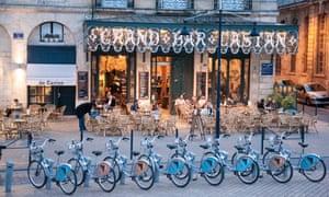 Bike-share bicylcles outside Bordeaux's Grand Bar Castan.