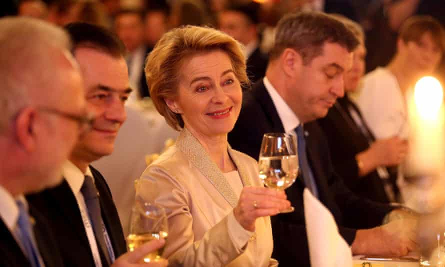 Ursula von der Leyen, president of the European commission, beside the Romanian prime minister Ludovic Orban (left) at a state dinner in Munich