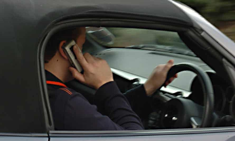 A man using a phone while driving