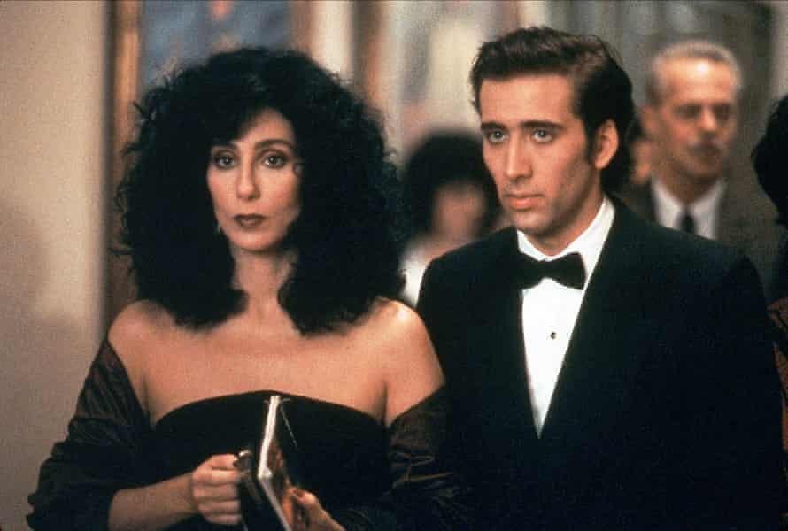 Cher and Nicolas Cage in formal dinner dress, looking pensive