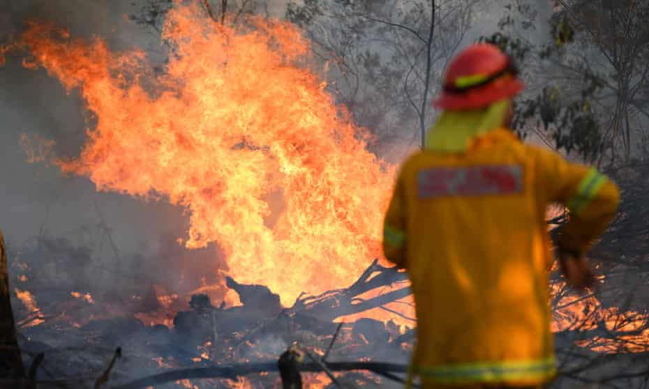A firefighter works to contain a bushfire near Glen Innes, New South Wales, Australia. Three people have been killed and 150 homes destroyed in the latest fires.