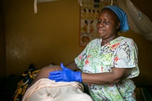 Anita Fakoli, head midwife, with a patient
