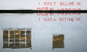 Graffiti art is seen on a wall next to the Regent's Canal, in Camden in London.