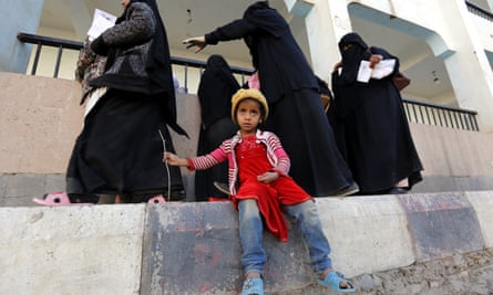 A displaced Yemeni child waits for her mother registering at an evacuation center after fleeing home in the war-affected port city of Hodeidah.