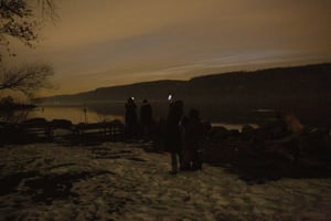 A great conjunction of Jupiter and Saturn on the December solstice, Hastings-On-Hudson, New York, USA - 21 Dec 2020Mandatory Credit: Photo by Gina M Randazzo/ZUMA Wire/REX/Shutterstock (11656661j) Residents of Hastings-on-Hudson, NY at MacEachron Waterfront Park viewing Jupiter and Saturn, the largest planets in our solar system, appearing a tenth of a degree apart in the night sky, an event called the great conjunction. The bright planets are visible despite very heavy cloud cover over the Hudson River and the Palisades. A great conjunction of Jupiter and Saturn on the December solstice, Hastings-On-Hudson, New York, USA - 21 Dec 2020