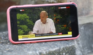 Dominic Cummings appears on a mobile phone during his press conference