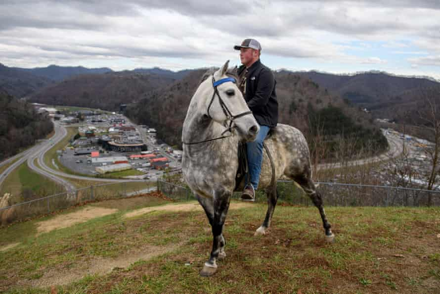 Justin Patrick, 17, sits atop a Rocky Mountain horse above the city of Pikeville, a sturdy breed of horse that, despite its name, was bred in the mountains of Kentucky to navigate the rough terrain of steep mountains and river valleys. Justin has no plans to enter coal mines after finishing high school.
