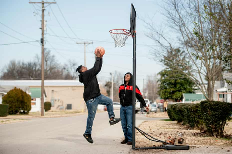 Jemere Brock, 13, (left) and Tank Borders, 13, play basketball on December 21 in Kennett, Missouri.