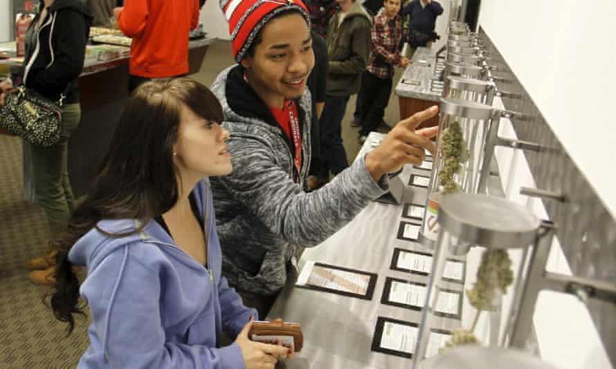 Shoppers browse legal recreational marijuana sales in Portland, Oregon.