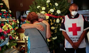 Mourners honour a nurse who died of coronavirus in Mexico.