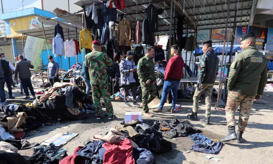 Security forces at market with clothes on ground