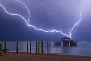 Summer lightning storm over Brighton's West PierDespite the intensity of this storm, the size of this particular lightning strike and the accompanying boom of thunder made me jump out of my soaking wet skin Photograph: AlbiOne/GuardianWitness