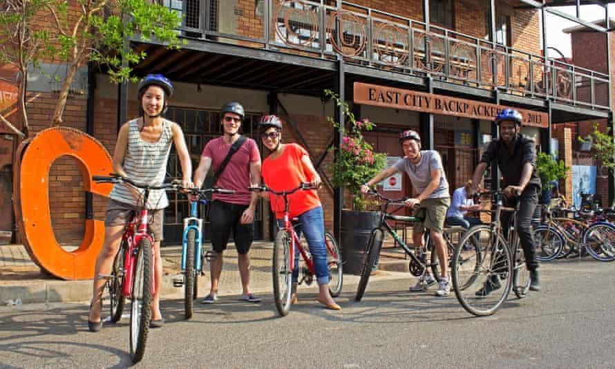 Cyclists line up outside Curiocity Backpackers hostel, Johannesburg, South Africa.