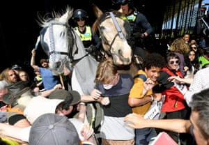 Police horses in a crowd of protesters