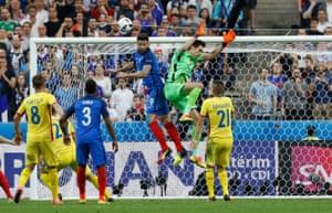 Goalkeeper Tatarusanu is beaten to the ball by Giroud.
