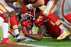 Williams rushes the ball against San Francisco 49ers defense and has his helmet stripped.