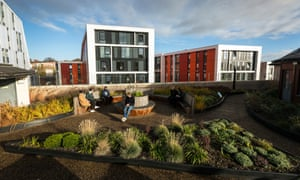 Students sit in roof garden at the Newton building at Nottingham Trent University