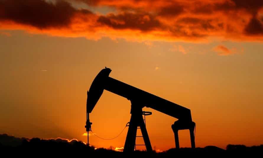 An oil pump is seen at sunset