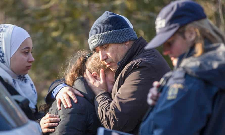 A man from Syria hugs his daughter after they were detained by the RCMP as they illegally crossed the US-Canada border near Hemmingford, Quebec, 28 February 2017.