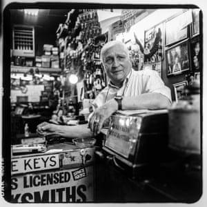 Raymond Herskovits inside of his miniature storefront, Mel's Locksmiths at 4 East 170th Street