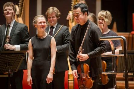 Conductor Mirga Gražinytė-Tyla with violinist Ning Feng at Symphony Hall, Birmingham.