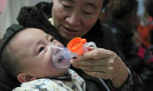 A baby with respiratory disease undergoing inhalation therapy at a hospital in Beijing