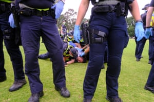 Melbourne, Australia: Police detain a protester during a rally against 'mandatory' Covid-19 vaccinations