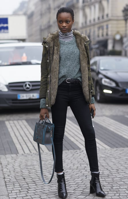 A visitor to Paris fashion week, January 2017, demonstrates the navel tuck