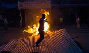Supporters of defeated presidential candidate Raila Odinga light fires and build roadblocks following the re-election of Uhuru Kenyatta as Kenyan president