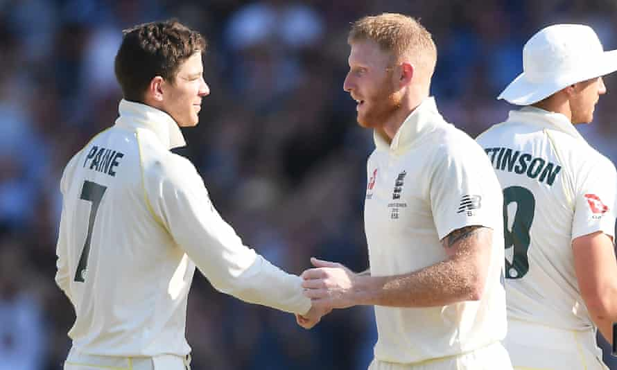 Tim Paine shakes hands with Ben Stokes in the aftermath of Sunday's drama.