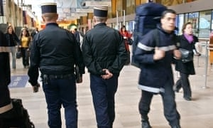 French gendarmes patrol Gare de Lyon train station in Paris.