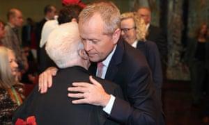 The opposition leader, Bill Shorten, hugs a member of the public