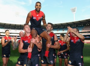 Heritier Lumumba is chaired off by Melbourne players after playing his 200th AFL game.