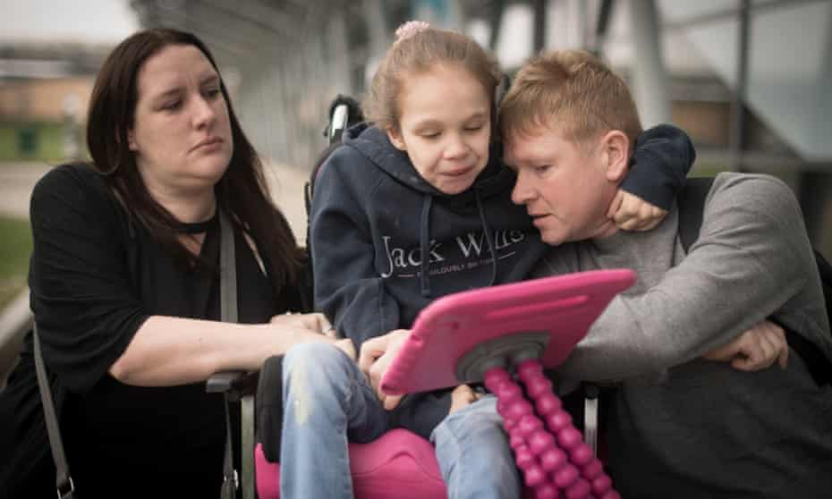 Emma Appleby, Lee Moore and their daughter Teagan, who has severe epilepsy, at Southend airport.