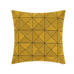 Cushion with a woven geometric pattern in yellow tones
