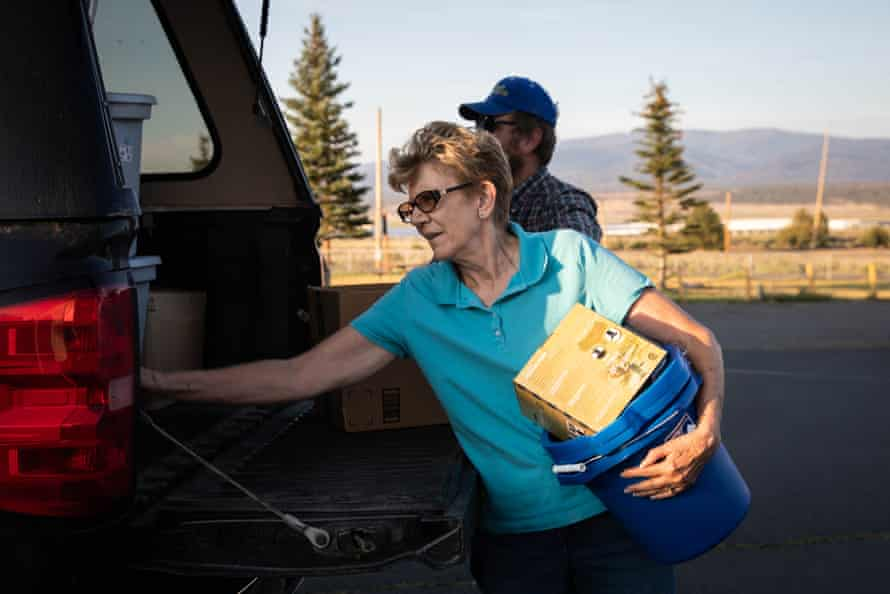 Leda Hunter helps to unload donations from Valerie O'Dai's truck at the Bly fire department.