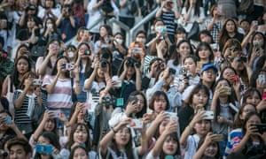 Boarding on obsession: K-pop fans 'falsely' check in on