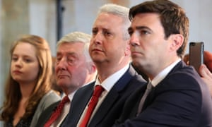 Tony Lloyd and Ivan Lewis sit next to Andy Burnham, before he was announced as the Labour candidate who will fight to become the mayor of Greater Manchester.