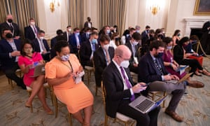 Here's some of White House press corps (including the Guardian's David Smith on the right towards the back with the massive pale blue face mask), hoping Joe Biden would take questions at the end of his address. The president did not.