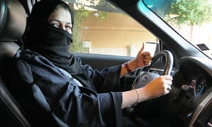 A Saudi woman drives a car