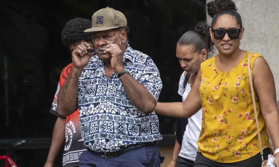 Close family of the three-year-old boy who died in a daycare minibus leave the Cairns court house on Tuesday.