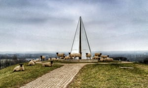Keen on Milton Keynes: happy sheep surround the Light Pyramid erected by Liliane Lijn.