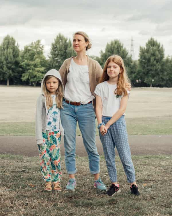 'Coming here has given structure to our days': Charlotte McCormack with Sylvie, 7, and Karen, 10, in Springfield Park, Hackney.