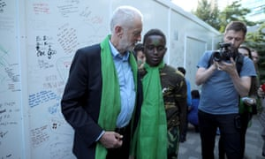 Jeremy Corbyn at a memorial wall on the one year anniversary of the Grenfell Tower fire