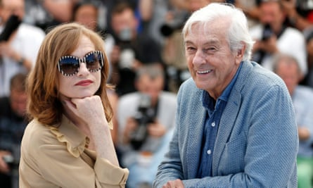 Isabelle Huppert and Paul Verhoeven (R) pose during the photocall for Elle.