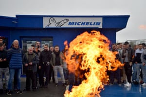 La Roche sur Yon, France Employees stand next to burning wood and tyres during a protest in front of the Michelin factory after the announcement of the closure of the site. Michelin announced the closure at the end of 2020 of La Roche sur Yon factory, employing 610 workers