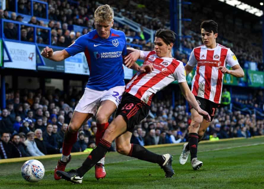 George Dobson of Sunderland tackles Cameron McGeehan of Portsmouth in their EFL Sky Bet League One match at Fratton Park on 1 February 2020