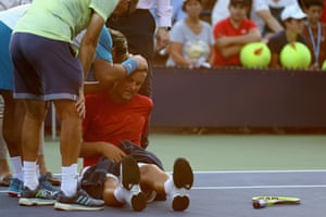 Russia's Mikhail Youzhny lays on the court while suffering from heat exhaustion during his match against Marcos Baghdatis.