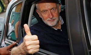 Jeremy Corbyn gives the thumbs up during a visit to Manchester